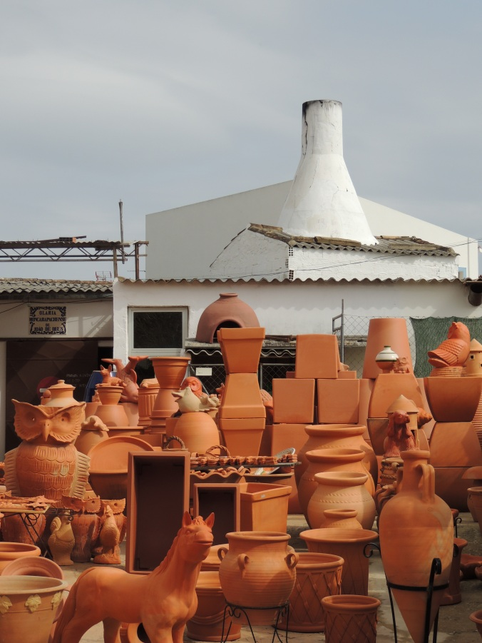 yard of a pottery filled with urns, pots and pottery animals