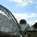 Glass roofs and a beehive at Kew