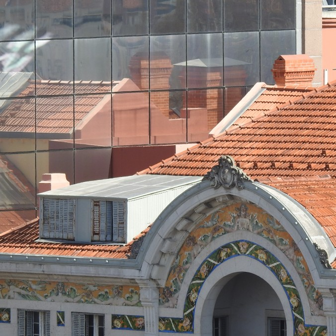 Lisbon rooftops from a distance and in reflection