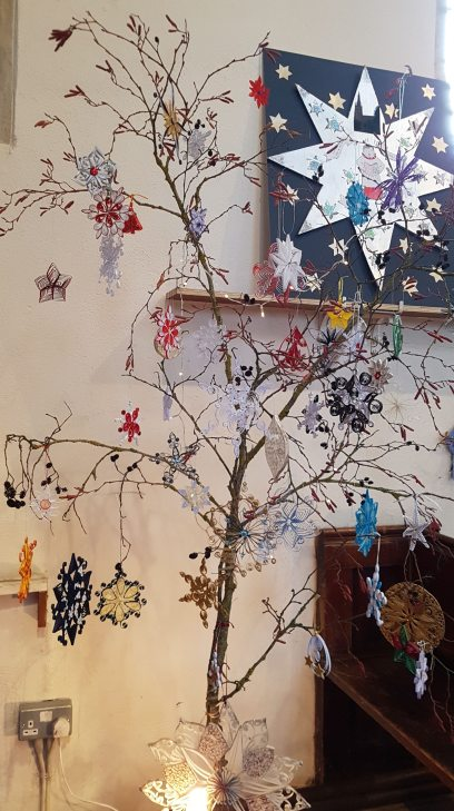 53 quilled stars on a very large branch